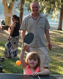 Family playing tables tennis