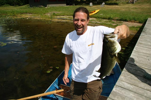 Camp Woodbury man holding a fish