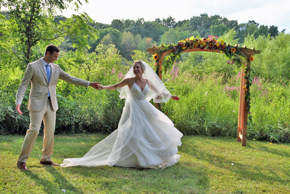 Married couple dancing on the lawn of Camp Woodbury