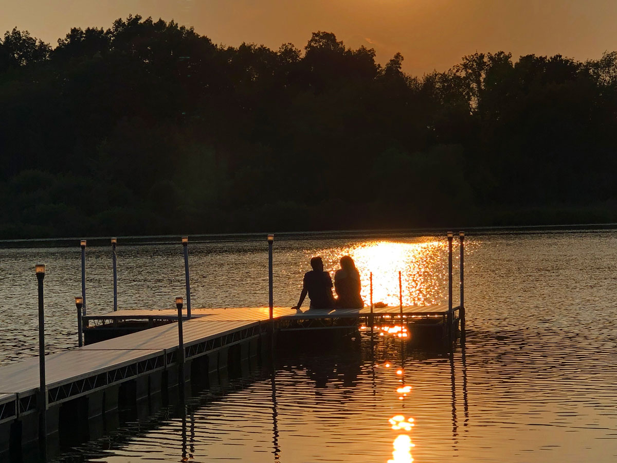 Couple out on the dock on a summer evening