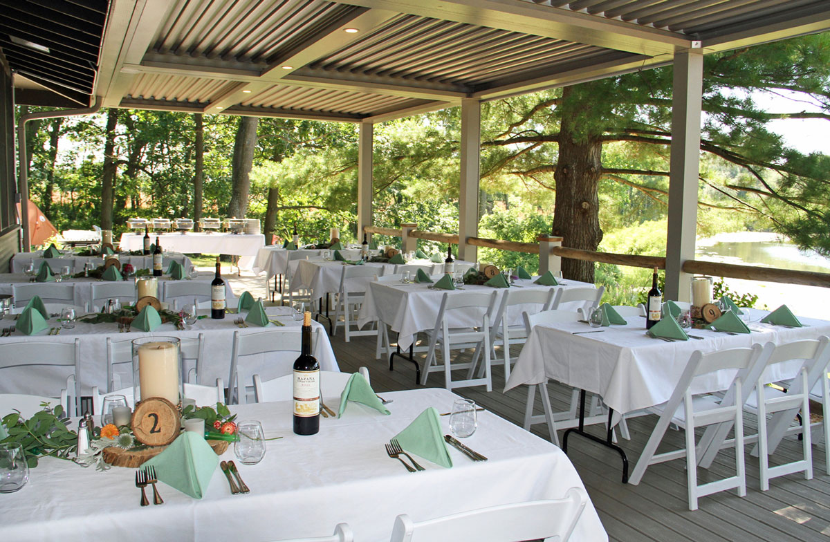 Outdoor wedding tables under the lodge deck